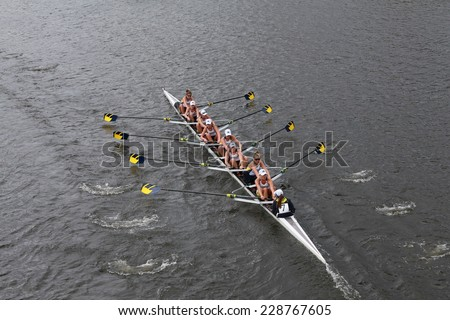 BOSTON - OCTOBER 19, 2014: Michigan University Rowing races in the Head of Charles Regatta Women's Championship Eights - stock photo