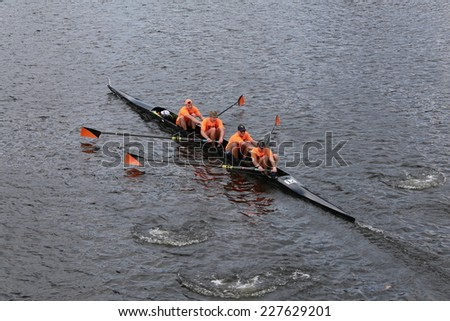 BOSTON - OCTOBER 19, 2014: New York Athletic Club races in the Head of Charles Regatta Men's Championship Fours - stock photo