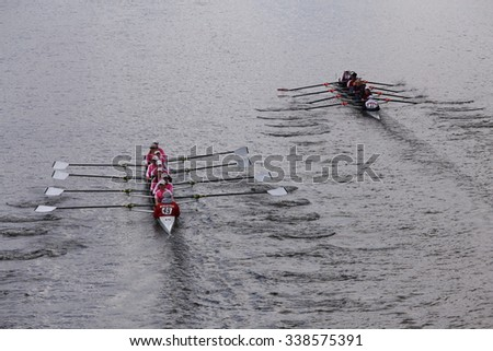 BOSTON - OCTOBER 18, 2015: Niskayuna (left)  and Winsor (right) races in the Head of Charles Regatta Women's Youth Eights [PUBLIC RACE] - stock photo
