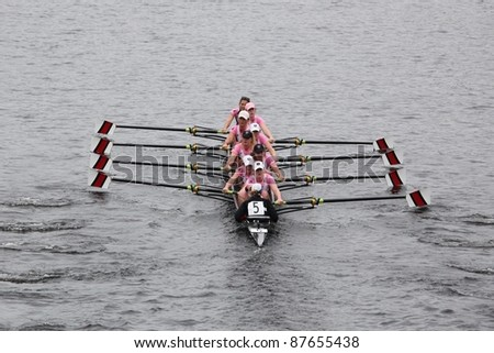 BOSTON - OCTOBER 23: North Eastern women's Eights races in the Head of Charles Regatta,  Williams College won with a time of 14:17 on October 23, 2011 in Boston, MA. - stock photo