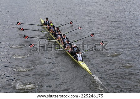 BOSTON - OCTOBER 19, 2014: Northeastern  University races in the Head of Charles Regatta Men's Championship Eights, Craftsbury Sculling Center won with a time of 14:20 - stock photo