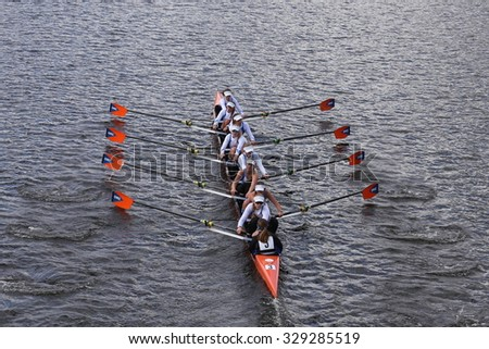 BOSTON - OCTOBER 18, 2015: OKC Riversport races in the Head of Charles Regatta Women's Youth Eights - stock photo