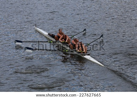 BOSTON - OCTOBER 19, 2014: Old Dominiuon University races in the Head of Charles Regatta women's Championship Fours - stock photo