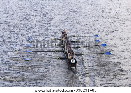 BOSTON - OCTOBER 18, 2015: PNRA Mercer Rowing races in the Head of Charles Regatta Women's Youth Eights [Public Event] - stock photo