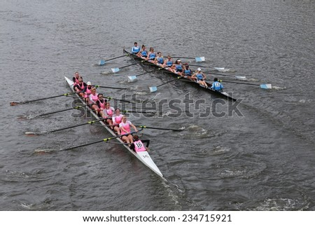 BOSTON - OCTOBER 19, 2014: Princeton University (left) and Columbia University(right)  races in the Head of Charles Regatta Women's Championship Eights - stock photo