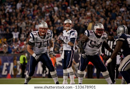 BOSTON - OCTOBER 16: Quarterback Tom Brady, No 12, prepares to throw pass at Gillette Stadium, New England Patriots vs. Dallas Cowboys on October 16, 2011 in Foxborough, Boston, MA - stock photo