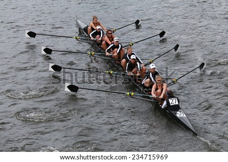 BOSTON - OCTOBER 19, 2014: Radcliff University Rowing races in the Head of Charles Regatta Women's Championship Eights - stock photo