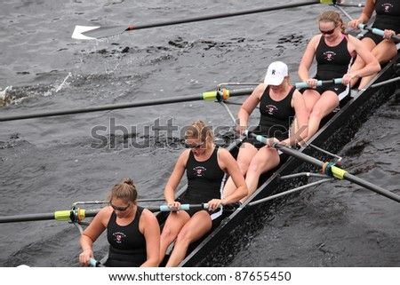 BOSTON - OCTOBER 23: Radcliffe Crew women's Eights races in the Head of Charles Regatta.  Williams College won with a time of 14:17 on October 23, 2011 in Boston, MA. - stock photo