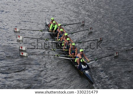 BOSTON - OCTOBER 18, 2015: Resilient Rowing Club races in the Head of Charles Regatta Women's Youth Eights - stock photo