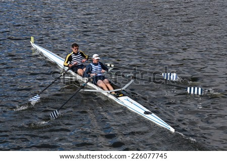 BOSTON - OCTOBER 19, 2014: Riverside Boat Clib with Kevin McDonnel and Robert White race in the Head of Charles Regatta Men's Master Doubles, 612endurance Rowing won with a time of 18:58 - stock photo