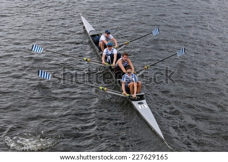 BOSTON - OCTOBER 19, 2014: Riverside Rowing Club races in the Head of Charles Regatta Men's Championship Fours - stock photo