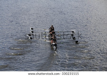 BOSTON - OCTOBER 18, 2015: Rose City Rowing races in the Head of Charles Regatta Women's Youth Eights - stock photo