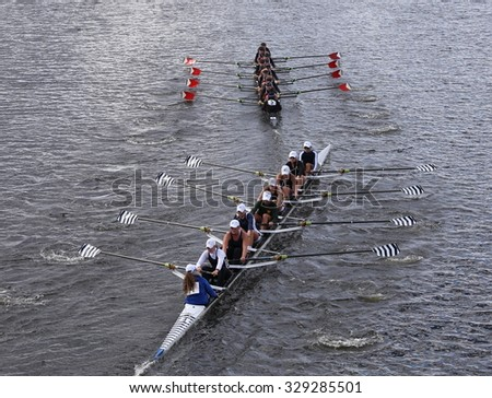 BOSTON - OCTOBER 18, 2015: Saratoga (bottom) and Marin Rowing(top) races in the Head of Charles Regatta Women's Youth Eights - stock photo