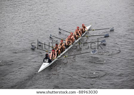 BOSTON - OCTOBER 23: Saratoga Rowing Association youth womens Eights races in the Head of Charles Regatta. Oakland Strokes won with a time of 17:12 on October 23, 2011 in Boston, MA. - stock photo