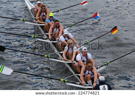 BOSTON - OCTOBER 19, 2014: Taurus Boat Club races in the Head of Charles Regatta Men's Championship Eights, Craftsbury Sculling Center won with a time of 14:20 - stock photo