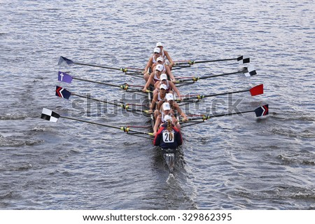 BOSTON - OCTOBER 18, 2015: TBC Racing races in the Head of Charles Regatta Women's Youth Eights - stock photo
