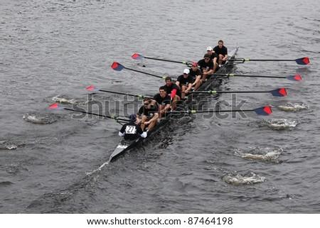 BOSTON - OCTOBER 23: University of Pennsylvania races in the Head of Charles Regatta, Harvard University won with a with a time of 14:17 on October 23, 2011 in Boston, MA. - stock photo