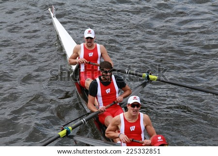 BOSTON - OCTOBER 19, 2014: University of Wisconsin races in the Head of Charles Regatta Men's Championship Eights, Craftsbury Sculling Center won with a time of 14:20 - stock photo
