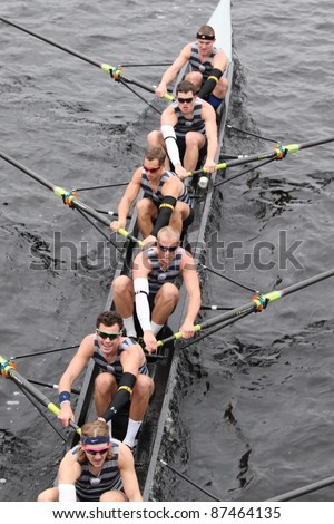 BOSTON - OCTOBER 23: US Naval Academy races in the Head of Charles Regatta, Harvard University won with a with a time of 14:17 on October 23, 2011 in Boston, MA. - stock photo