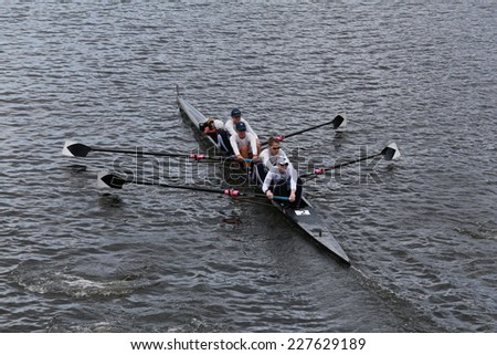 BOSTON - OCTOBER 19, 2014: US Rowingy races in the Head of Charles Regatta Men's Championship Fours - stock photo