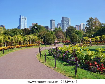 Boston Public Garden And City Skyline In Summer. Tropical Plants And  Colorful Floral Patterns In