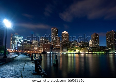 Boston's waterfront area at night in horizontal