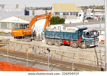 BOSTON, SEP.8: Mechanical digger excavator loading earth on dump dumptruck at a roadworks construction site in Auckland, New Zealand taken on Sep. 8, 2009. - stock photo
