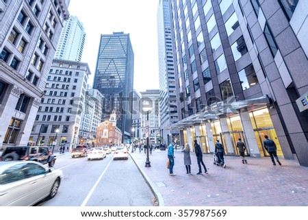 BOSTON - SEPTEMBER 12, 2015: Tourists along city streets. Boston attracts one and a half million people annually.