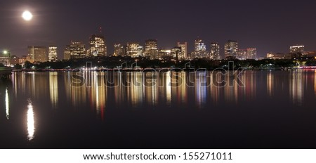 Boston skyline at Full Moon from Harvard University Sailing Center, Boston, MA, USA