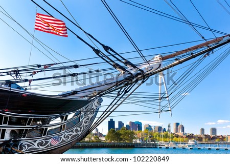 Boston skyline framed by the USS Constitution, oldest battleship in American history - stock photo