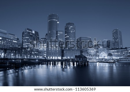 Boston. Toned image of Boston city skyline at night. - stock photo