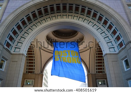 "Boston, USA - April 16, 2016: ""Boston Strong"" banner hanging from Rowes Wharf marking the Patriots Day holiday and Boston Marathon in 2016 in Boston."