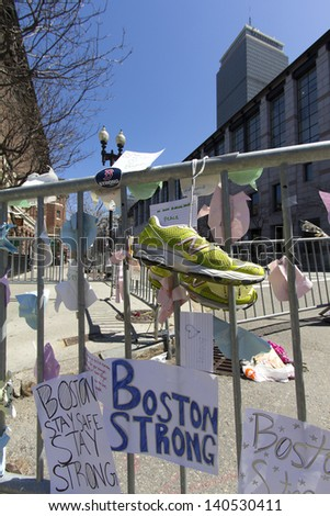 BOSTON, USA - APRIL 21: Locals and tourists left a lot of mementos and messages of courage at the several improvised memorials of the 2013 Boston Marathon bombing at Boylston st on April 21, 2013. - stock photo