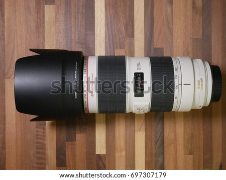 BOSTON, USA - AUGUST 16: One of the most used lens in the world, the Canon EF 70-200mm F/2.8 USM IS L II in a close-up shot showcasing its sturdy construction on August 16, 2017.
