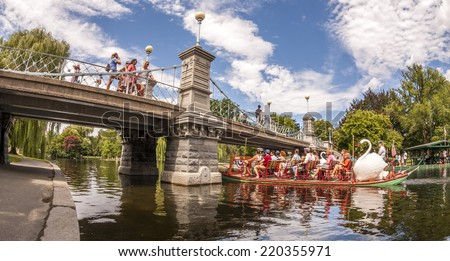 BOSTON, USA - JUNE 20, 2014: Panoramic view of Boston in MA, USA showcasing the architecture of the Boston Public Garden with some tourists going for a ride in the famous Swan Boats on June 20, 2014. - stock photo