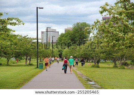 BOSTON, USA - JUNE 8, 2013: People visit Charles River esplanade park in Boston. Boston is the largest city in Massachusetts with urban area population of 4,180,000. - stock photo