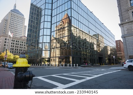 BOSTON, USA - OCTOBER 13; Urban reflections, Urban mirror image, Victorian style cathedral reflected  reflected in mirror glass facade of modern building.on October 13, 2014 in Boston, USA - stock photo