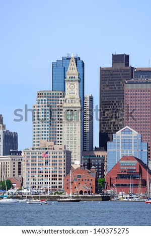Boston waterfront view with urban city skyline and modern architecture over sea. - stock photo
