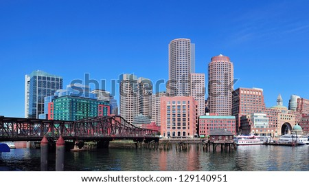 Boston waterfront with skyscrapers and bridge in the morning.