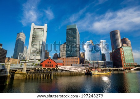 Boston waterfront with skyscrapers and bridge in the morning - stock photo