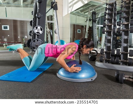 Bosu knees push up push-up woman at gym workout exercise - stock photo
