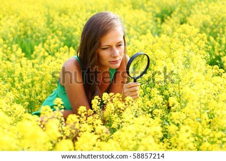 botanist woman in yellow flower - stock photo
