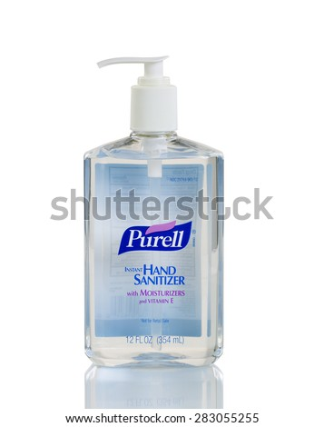 BOTHELL, WA-MAY 31, 2015: Purell hand sanitizer in plastic bottle isolated on white with reflection.  - stock photo