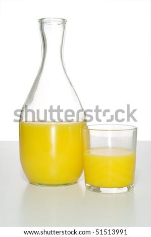 Bottle and glass of orange juice in studio - stock photo