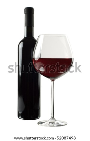 Bottle and glass of red wine isolated on white background. Focus on wineglass. - stock photo