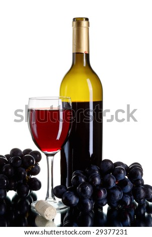 Bottle and glass of red wine with grapes on white background