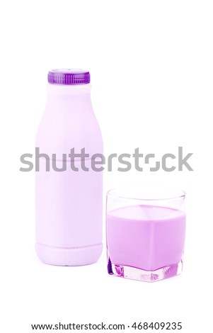 Bottle and glass of strawberry  milk over white