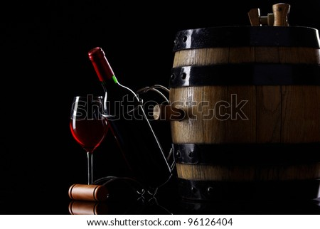 Bottle and glass of wine in black