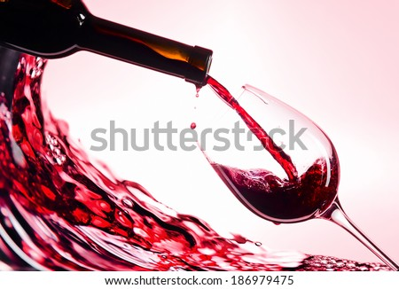 bottle and glass with red wine  - stock photo