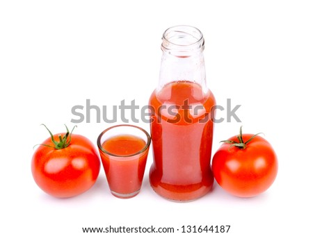 Bottle and glass with  tomato juice and ripe tomatoes, isolated on white background